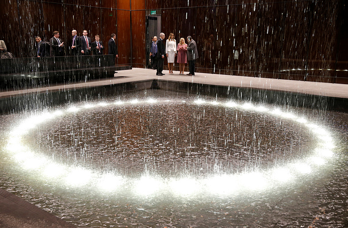 US first lady Melania Trump and Sara Netanyahu look at the Contemplative Court fountain during a visit to the African American Museum of History and Culture in Washington, US, February 15