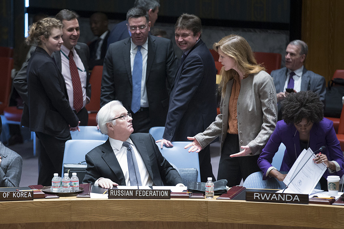 Russia's UN Ambassador Vitaly Churkin and United States' UN Ambassador Samantha Power interact before an UN Security Council meeting on the Ukraine crisis, 2014