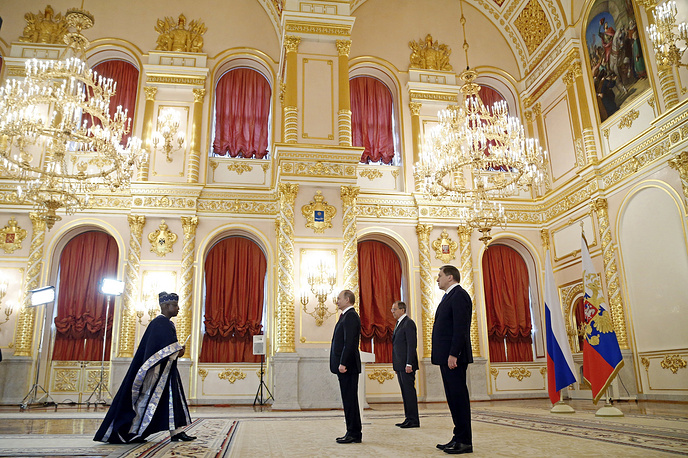 Russian President Vladimir Putin receives credentials from Benin's ambassador to Russia Rene Coto Sounon at a ceremony of receiving credentials in the Kremlin in Moscow, Russia, March 16