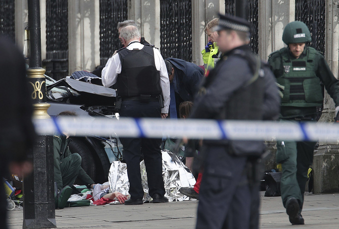 Emergency personnel tend to an injured person close to the Palace of Westminster
