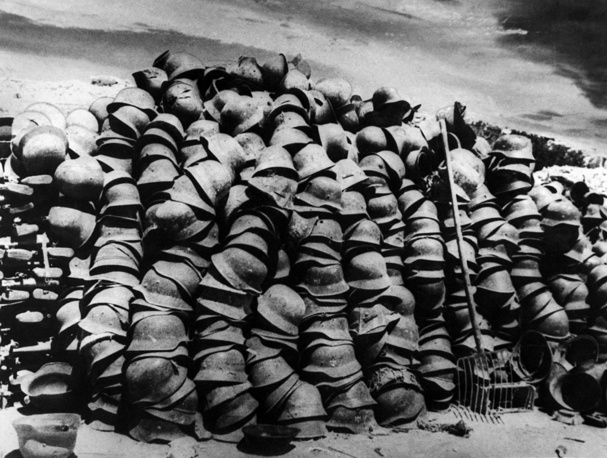 Soldiers' helmets piled high somewhere on the Eastern Front, 1941
