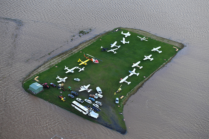 An aerial photograph of floodwaters engulfing aircraft parked at the airport, Lismore, New South Wales, Australia, March 31
