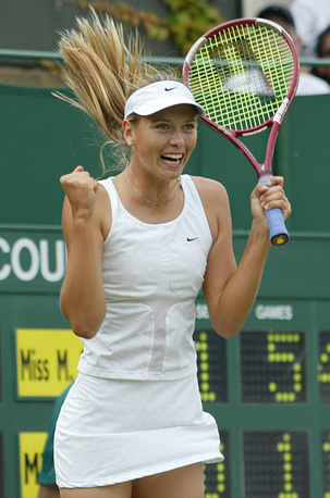 Maria Sharapova reacts as she wins a match at the All England Lawn Tennis Championships at Wimbledon, 2003