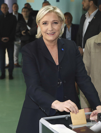 Marine Le Pen casts her vote for the first-round presidential election in Henin-Beaumont, northern France