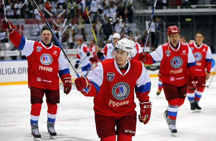 Russian President Vladimir Putin reacts after end of Gala match of the hockey teams of the 'Night League' at the Shayba Olympic Arena in Sochi, Russia, May 10