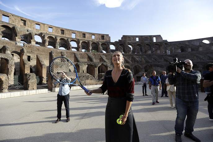 Russia's Maria Sharapova prepares to hit the ball during an exhibition at the Rome ancient Colosseum ahead of the Italian Open tennis tournament, Italy, May 14