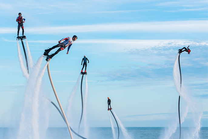 Participants in the Flyboard Record international extreme water sports festival in the Black Sea, offshore from Sochi's Sport Inn hotel, Russia, May 21