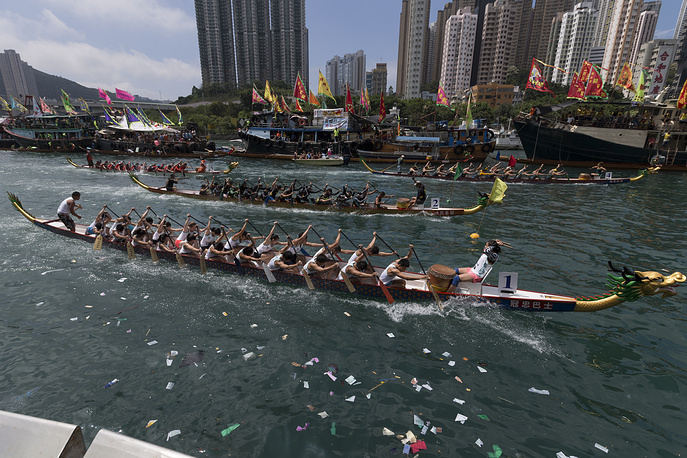 Dragon boat teams race toward the finish line during the Dragon Boat festival in Aberdeen fishing harbour in Hong Kong, China, May 30
