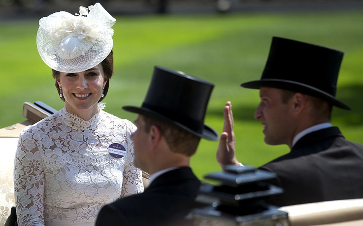Britain's Kate, Duchess of Cambridge, Prince William and Prince Edward seen in an open carriage on the first day of the Royal Ascot horse race