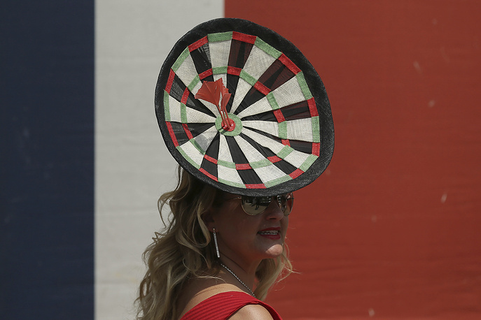 A racegoer poses for photographers on the second day of the Royal Ascot horse race
