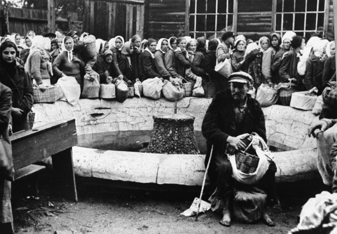 Residents of Nazi-occupied Babruysk forced to give up their provisions to Hitler's invading army, August 11, 1941