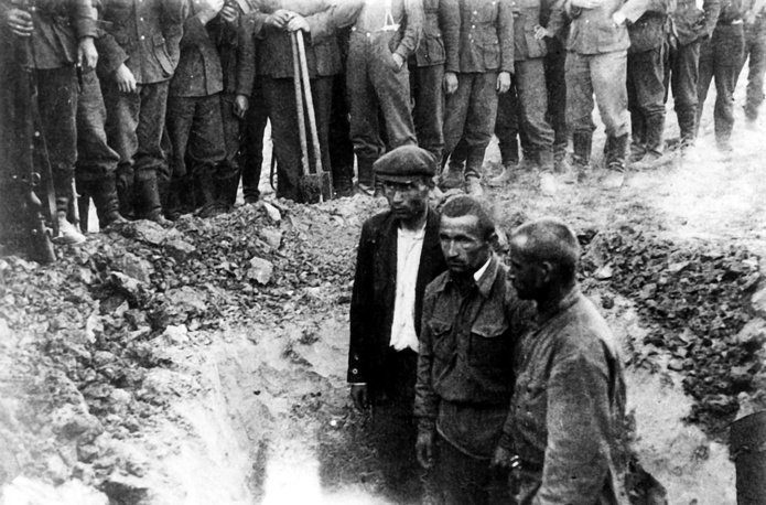 Soviet prisoners of war pictured in a pit they were forced to dig before being executed in cold blood, 1941