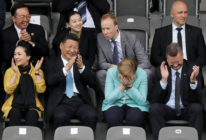 Chinese President Xi Jinping and his wife Peng Liyuan, German Chancellor Angela Merkel, Reinhard Grindel, President of the German Football Association seen a soccer game of U12 children between Germany and China during their visit in Olympic Park in Berlin, Germany, July 5