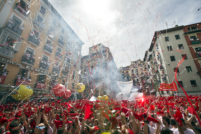 Thousands of revellers pack the plaza at the town hall in Pamplona, Spain