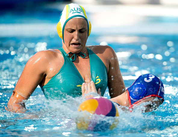Bronte Halligan of Australia in action against Ekaterina Prokofyeva of Russia during the women's water polo Group D match between Australia and Russia at the 17th FINA Swimming World Championships in Budapest, Hungary, July 18
