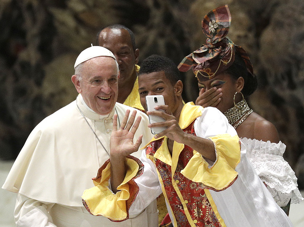 A pilgrim takes a selfie with Pope Francis before the opening of the weekly general audience in the Paul VI Hall at the Vatican, August 2