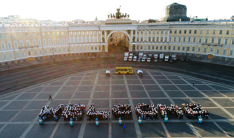 About 1,500 students hold a flash mob in Palace Square in support of St Petersburg's candidacy as a host city for the 2019 General Assembly of the UN World Tourism Organisation, St Petersburg, Russia, September 6