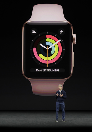 Apple CEO Tim Cook shows new Apple watch at the Steve Jobs Theater