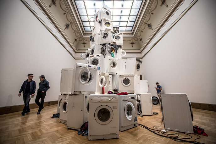 Visitors walk by an artwork titled 'We All Want to Be Cleaned' by Czech artist Kristof Kintera at his exhibition 'Nervous Trees' at Rudolfinum Gallery in Prague, Czech Republic, September 13