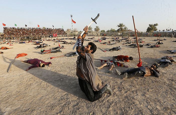 Iraqi actors perform the epic of Imam Hussein, as part of the Ashura festivals in Sadr City, Baghdad, Iraq, October 1