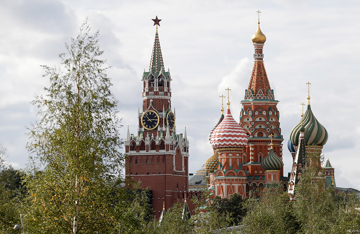A view of the Moscow Kremlin's Spasskaya Tower and St Basil's Cathedral from Zaryadye park