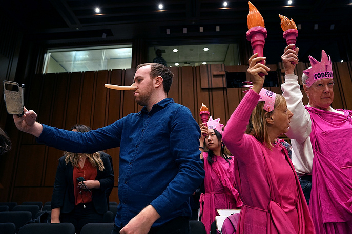 A group of protesters seen before the start of a hearing where US Attorney General Jeff Sessions testified to the Senate Judiciary Committee in the Hart Senate Office Building on Capitol Hill, Washington, USA, October 18. Committee members questioned Sessions about Russian intereference in the 2016 presidential election