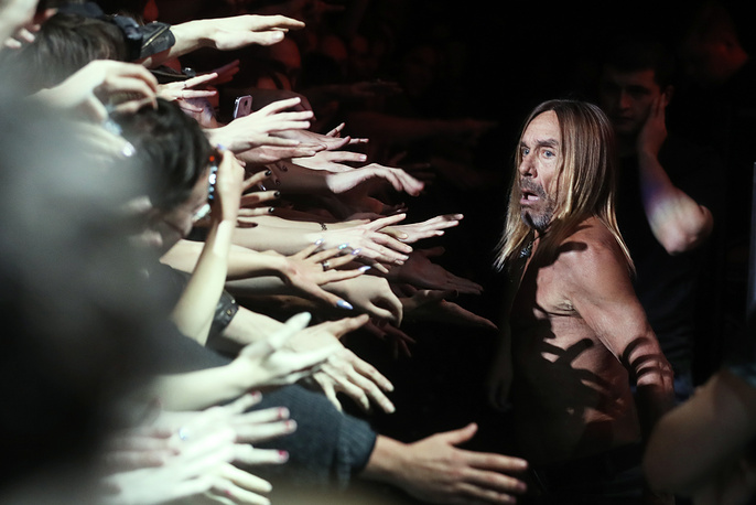 """American punk rock musician Iggy Pop greets his fans during a concert in Moscow's Stadium Live in support of his latest album titled """"Post Pop Depression"""", October 19"""