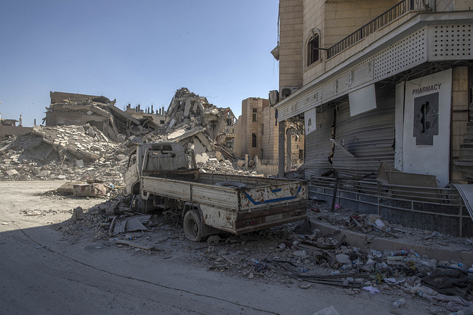A heavily destroyed street in Raqqa