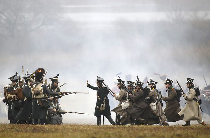 Men dressed as 1812-era Russian and French soldiers re-enact a staged battle near the Belarus village of Bryli, about 115 kilometers east of the capital, Minsk, Belarus, to mark the 205th anniversary of the Berezina battle during Napoleon's army retreat from Russia, November 26