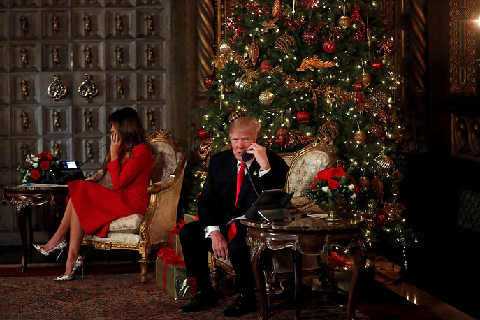 US President Donald Trump and First Lady Melania Trump participate in NORAD (North American Aerospace Defense Command) Santa Tracker phone calls with children at Mar-a-Lago estate in Palm Beach, USA, December 24