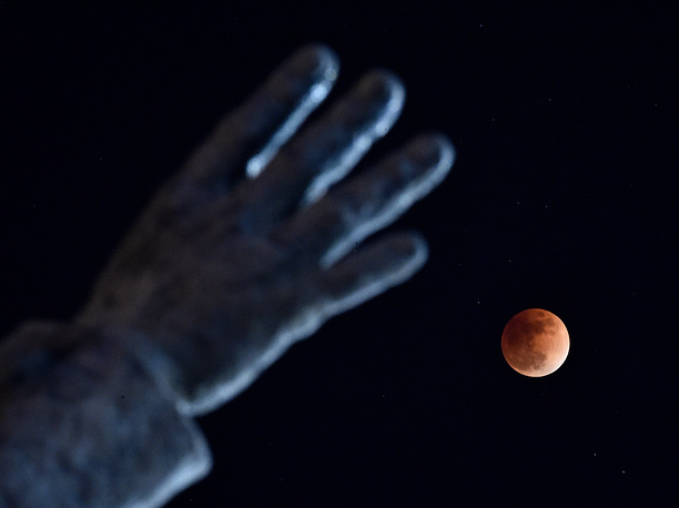 A lunar eclipse during a blue moon and a supermoon in Vladivostok, Russia