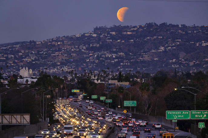 A super blue blood moon is seen behind the Hollywood hills in Los Angeles, USA