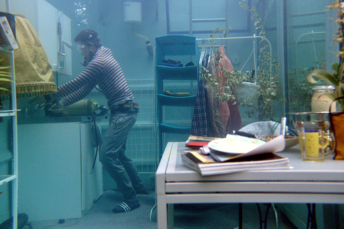 Tomas Kleiner from the Art Academy in Duesseldorf does daily chores in a diving container in Duesseldorf, Germany, January 31. The artwork is called 'Underwater Life Design'