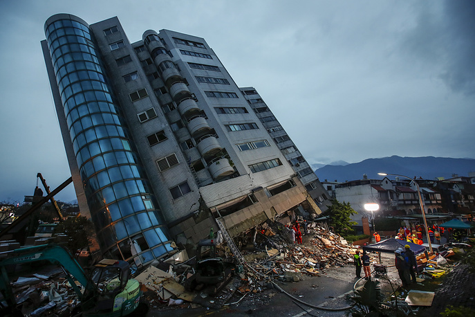 Rescue services search for people in a damaged building after a magnitude 6.4 earthquake hit Hualien, Taiwan, February 7
