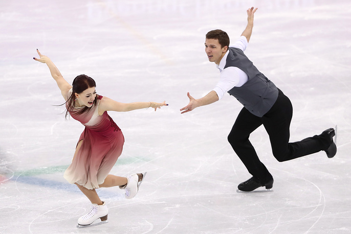 Ice dancers Ekaterina Bobrova and Dmitri Soloviev perform their free dance as part of the figure skating team event