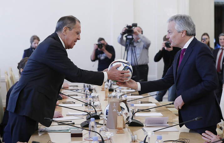 Russian Foreign Minister Sergei Lavrov and Belgian Minister for Foreign Affairs Didier Reynders exchange soccer balls prior their talks in Moscow, Russia, February 13