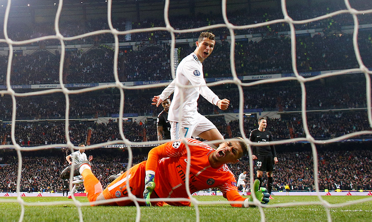 Real Madrid's Cristiano Ronaldo celebrates after Marcelo scores their third goal at Real Madrid vs Paris St Germain football match in Madrid, Spain, February 14
