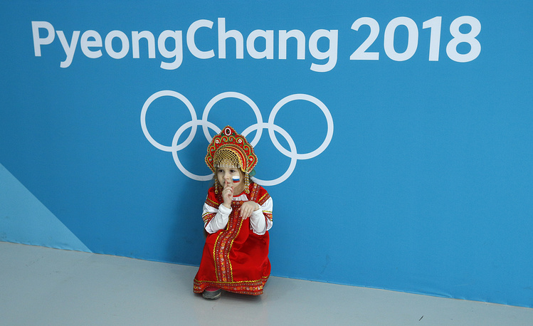 A young fan poses at the Olympic hockey venue in Pyeongchang, South Korea, February 21