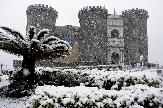 Snow covers the land around Maschio Angioino during cold weather in Naples, Italy