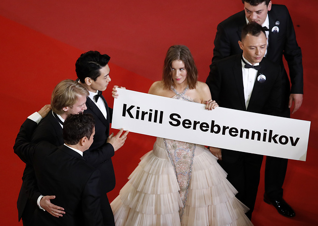 Russian actress Irina Starshenbaum and other cast members hold a sign with the name of Russian director Kirill Serebrennikov as they arrive for the screening of 'Leto' during the 71st annual Cannes Film Festival, in Cannes, France May 9. Kirill Serebrennikov is currently under house arrest