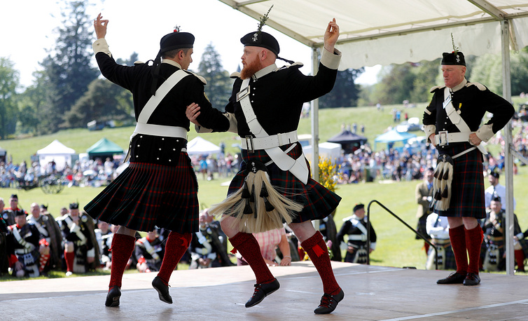 The Atholl Highlanders demonstrate a dance at the Atholl Gathering and Highland Games at Blair Castle, Scotland, May 27