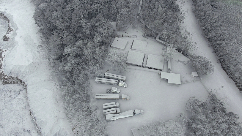 An aerial view of the disaster zone, blanketed in volcanic ash after the eruption of the Volcan de Fuego