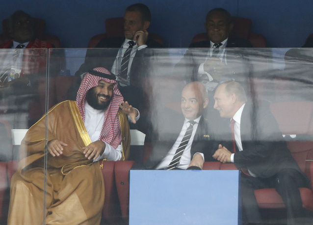 Saudi Arabia Crown Prince Mohammed bin Salman, FIFA President Gianni Infantino and Russian President Vladimir Putin watch the match between Russia and Saudi Arabia which opens the 2018 soccer World Cup at the Luzhniki stadium in Moscow, June 14