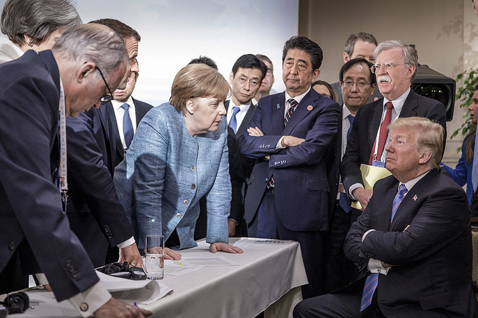 French President Emmanuel Macron, German Chancellor Angela Merkel and Japan's Prime Minister Shinzo Abe speaking to US Presidend Donald J. Trump during the second day of the G7 meeting in Charlevoix, June 9