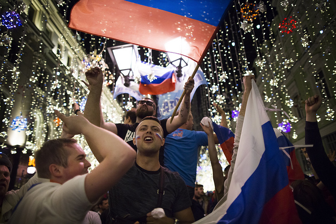 Russian football fans celebrate the national team victory after the group A match between Russia and Egypt during the 2018 soccer World Cup in Moscow