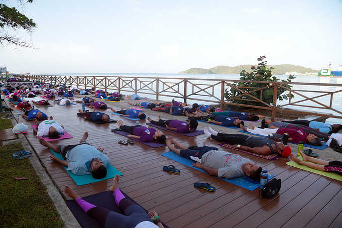 People participate in a group yoga event at the Boardwalk in Chaguaramas, Trinidad and Tobago