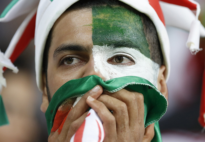 A supporter of Iran reacts after the end of the group B match between Iran and Portugal. The game ended 1-1