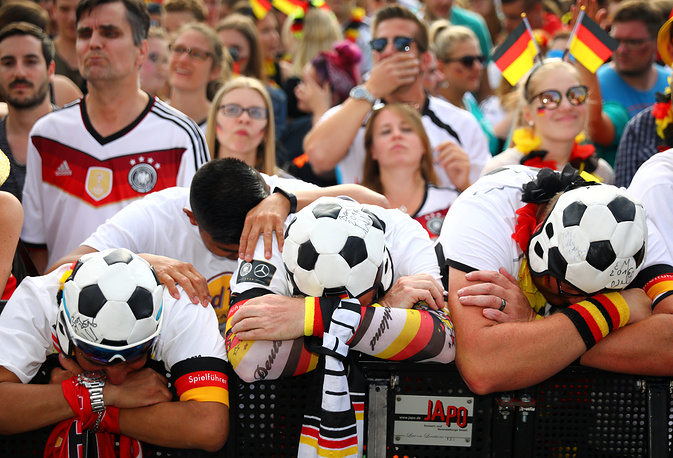 German fans react with disappointment as they watch the World Cup Group F - South Korea vs Germany match at a public viewing area at Brandenburg Gate, June 28. Germany lost 2-0