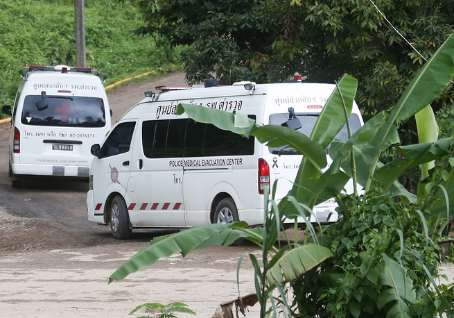 Two ambulances arrive near the cave to wait for more evacuations of the boys and their coach who have been trapped since June 23