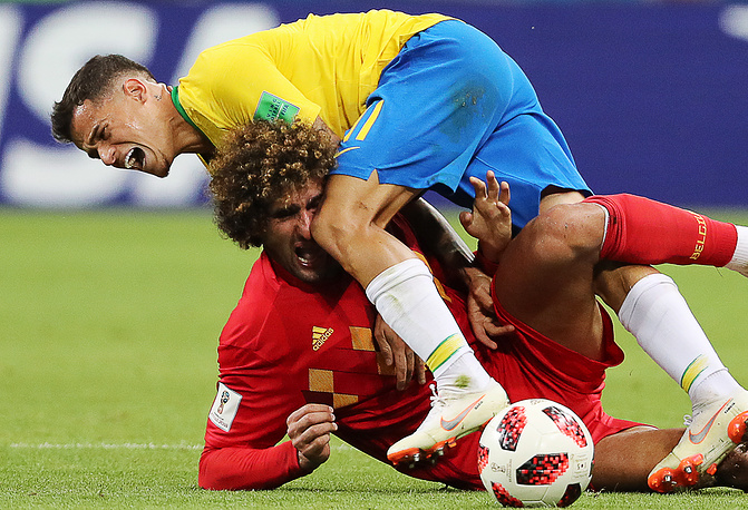 Belgium's Marouane Fellaini and Brazil's Philippe Coutinho in a Knockout Stage quarterfinal football match between Brazil and Belgium at Kazan Arena at. Belgium won 2-1